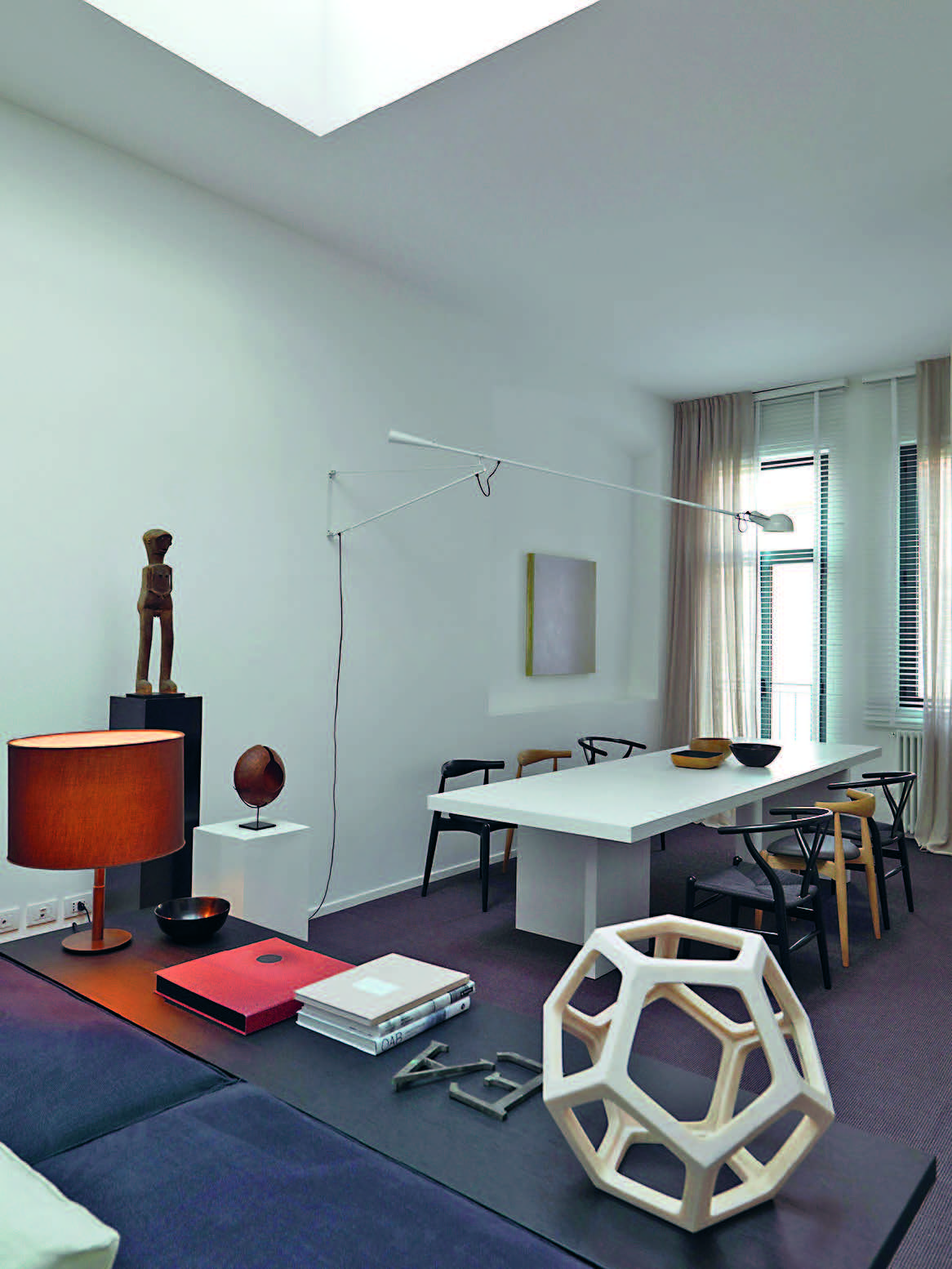 The Dining Area Next To Entrance Table By Philippe Allaeys For E15 Chairs Hans J Wegner Carl Hansen Son And Lamp 265 Flos Design Paolo