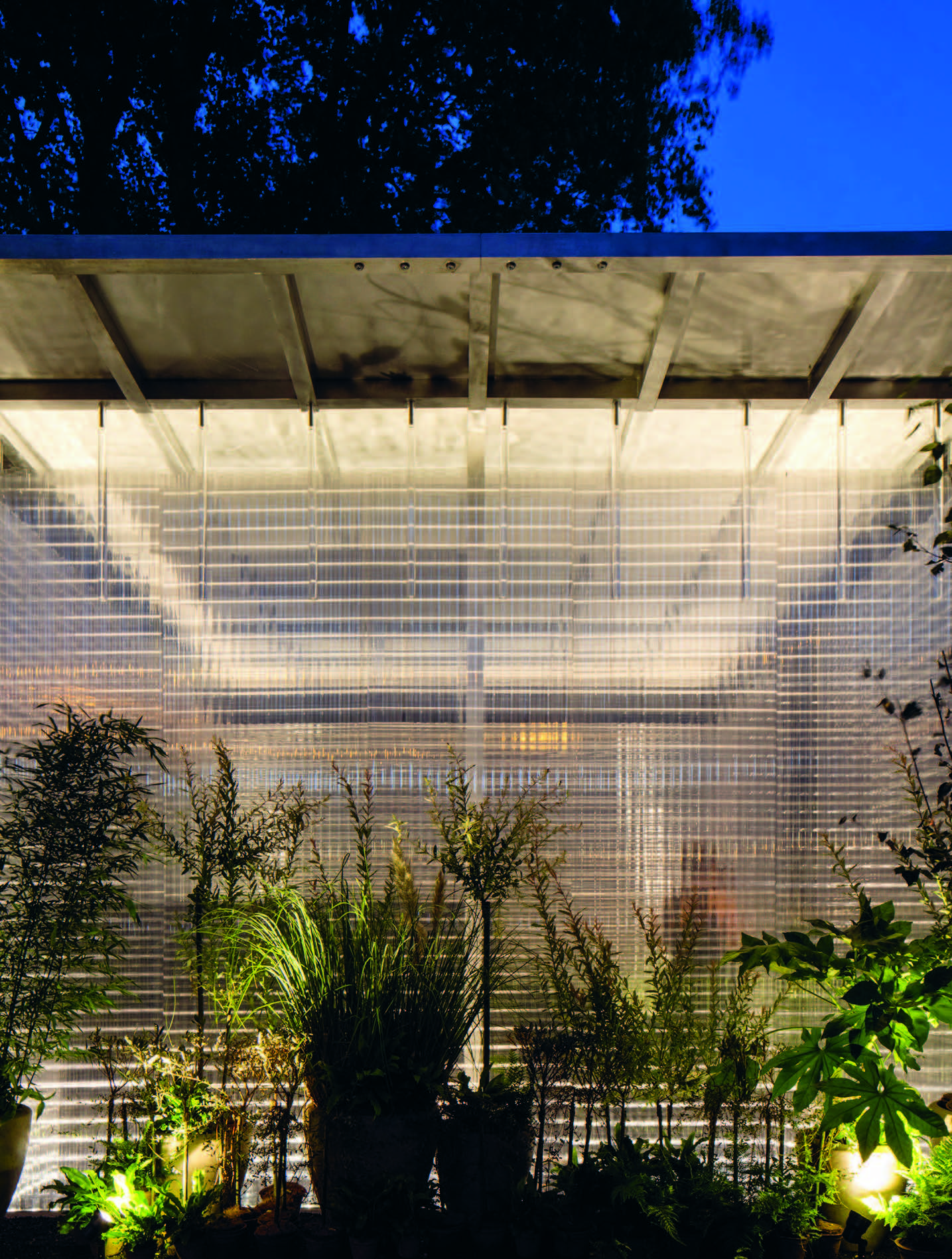 The Create Space, Surrounded By Outdoor Plants Set On A Threshold Protected  By The Roof Overhang.