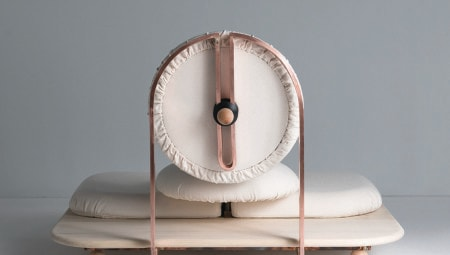 Asana, the chair by Mario Milana with copper frame, natural wood toulipier base and cushions with Khadi cotton liner.